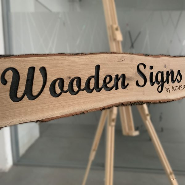 Wooden sign with engraved name